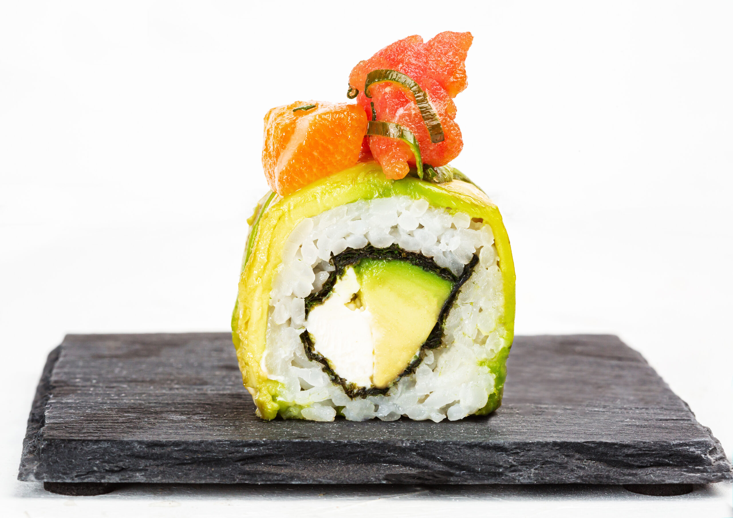 A closeup shot of delicious sushi roll on white background